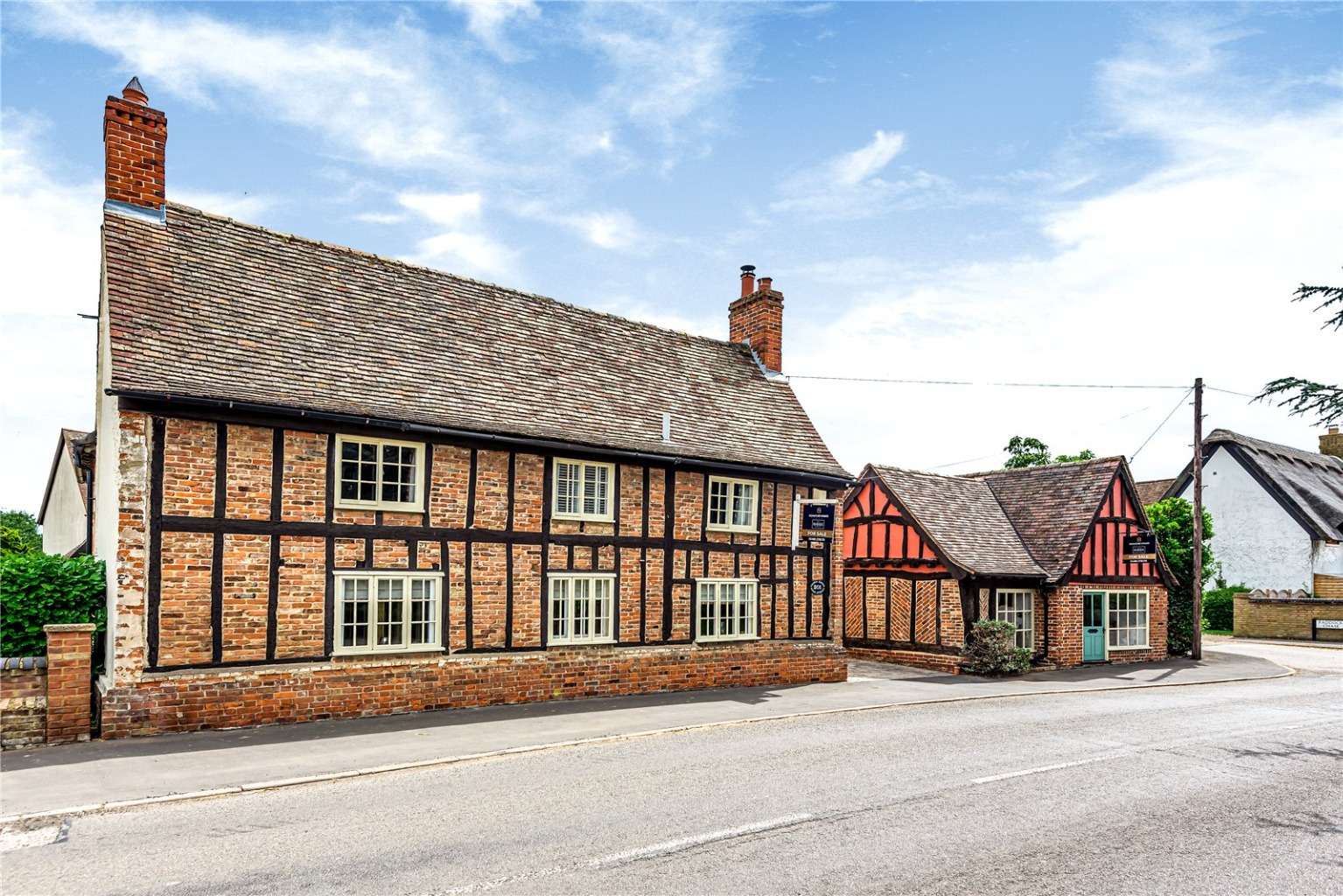 Striking, deceptively spacious, period red-brick and timber-frame cottage .