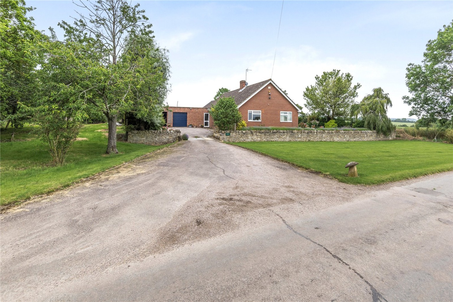 Set in the hamlet of Wintringham on the eastern outskirts of St Neots, this detached three-bedroom bungalow sits on a plot of over two acres and is surrounded by open countryside.