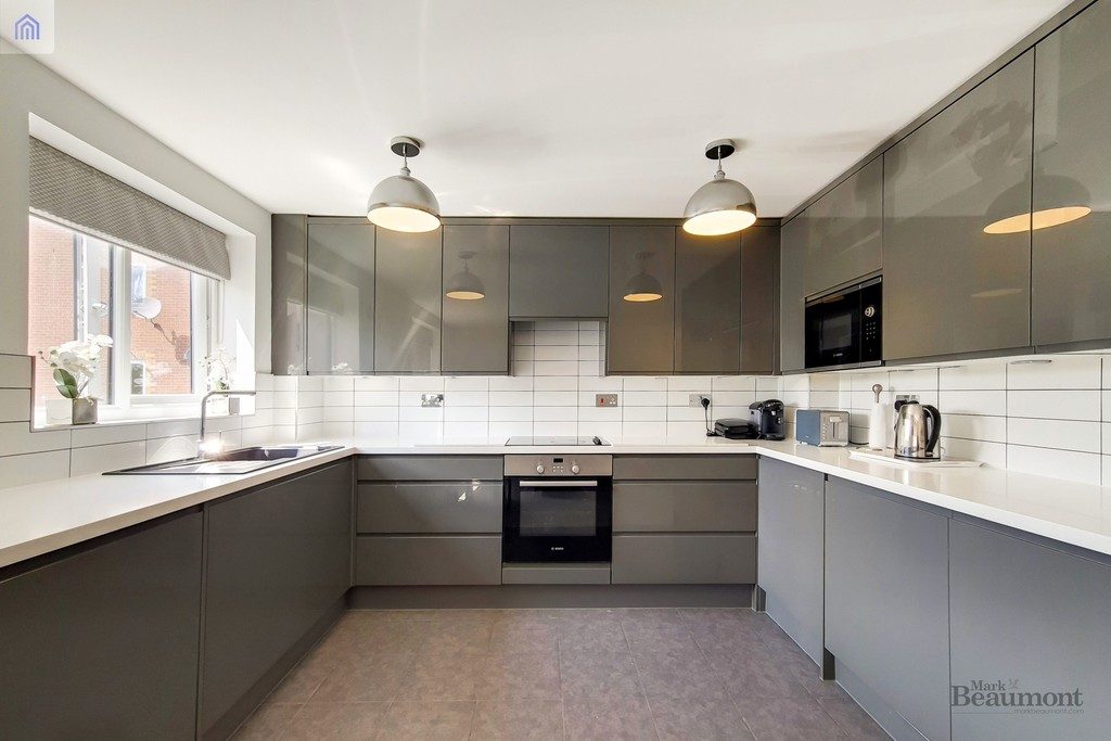 Modern, sleek, sophisticated. For sale is this very smart flat which is superb for the DLR, Lewisham Station as well as Blackheath and Greenwich. This flat is significantly improved over other flats in the same development. Must be seen.