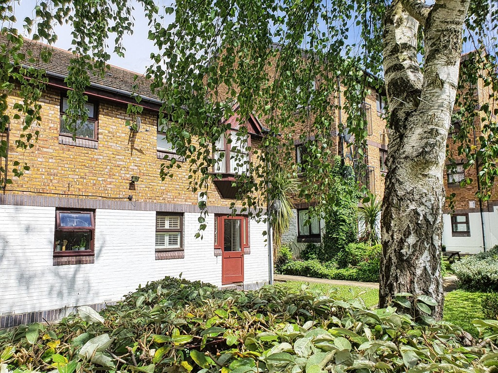 Garden flat with a garage and further parking. For sale is this one bedroom garden flat with leafy gardens, yet in a central location. Long lease.