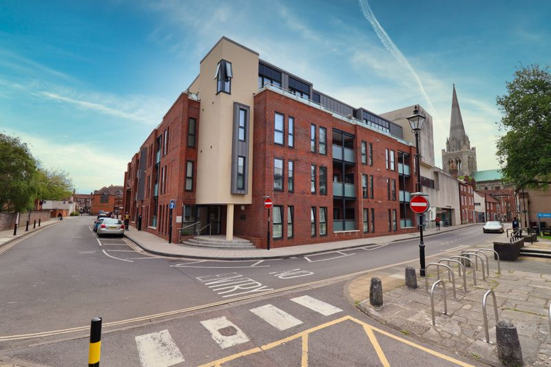 A stunning Two Bedroom first floor apartment situated in the heart of Chichester City Centre . Vesta is a development of beautifully designed contemporary apartment built by Vanderbilt Homes three years ago, with stunning views of the Cathedral.The property has the benefit of a West facing balcony, an allocated parking space in a secure gated underground car park and a lift to all floors. The accommodation comprises Two Bedrooms with an En-suite to the Main Bedroom and a further Family Bathroom, an open plan Kitchen/Living/Dining Room with NEFF integrated appliances.The property was constructed to a high specification with an air recycling system filtering fresh air from outside to inside and underfloor heating throughout the entire apartment.The historic Cathedral City of Chichester provides a wide variety of cultural, leisure and shopping facilities, including the internationally renowned Festival Theatre, Pallant House Gallery and museums. The nearby area hosts many sailing clubs and marinas provide exceptional facilities for boating and sailing enthusiast of all abilities. West Wittering and East Head offer stunning beaches and a wide choice of recreational and water related sporting facilities. The South Downs National Park can be found to the north of Chichester and provides miles of beautiful walks and rides.   Approximately 3½ miles to the North lies Goodwood with its' famous race course, golf courses and airfield and which is also home to the annual Festival of Speed and The Revival. Chichester benefits from a main line rail service to London Victoria (approximately 90 minutes) and the A27 provides access across the Coast to Brighton to the East and Southampton to the West.