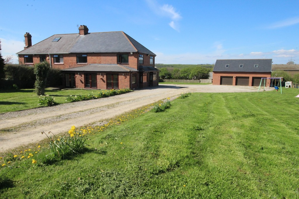 A substantial 4 bedroom house set in 3.2 acres, situated in a pleasant and quiet rural location. This property has ample space, inside and out, with a triple garage, large garden and a 2.6 acre grass paddock. Within easy access to the A1(M) and A19.