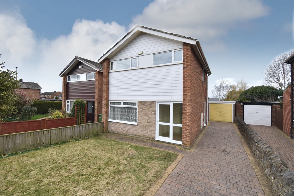 A modern detached three bedroom property featuring a spacious semi-open plan living/dining room whilst upstairs there is a modern bathroom, two double bedroom and a single. There is parking for several vehicles and a single garage.