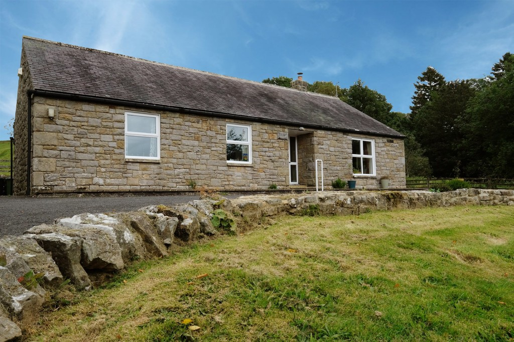 A detached stone-built three-bedroom bungalow set in the beautiful village of Greenhaugh on an elevated position enjoying stunning views across Northumberland National Park.