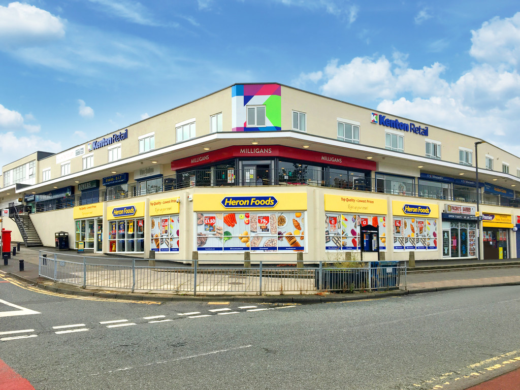 Refurbished retail units in a densely populated suburb.