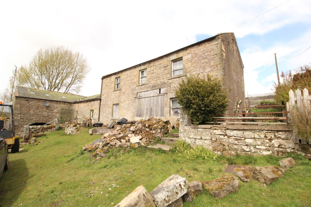 An exciting development opportunity to acquire a traditional stone built derelict farmhouse in need of full renovation together with various outbuildings including an attached single storey barn and separate workshop.