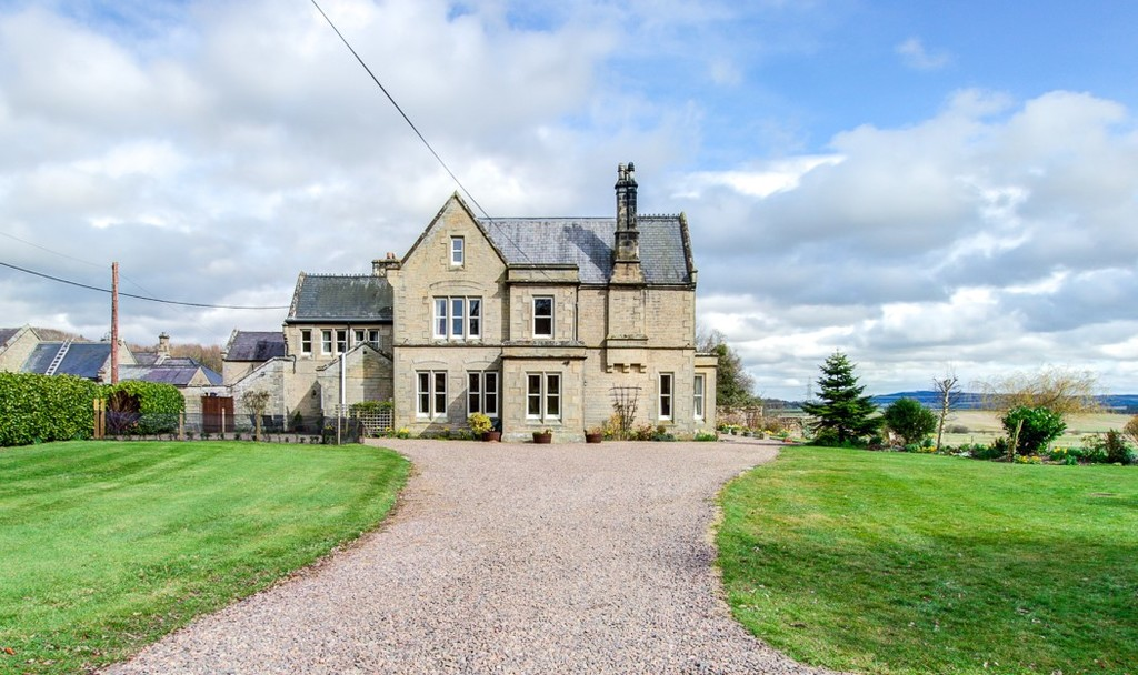 The Grange, a handsome stone built Victorian country house with adjoining two bedroom cottage. Proudly sitting amidst landscaped gardens, with far-reaching views over the Cheviot Hills.