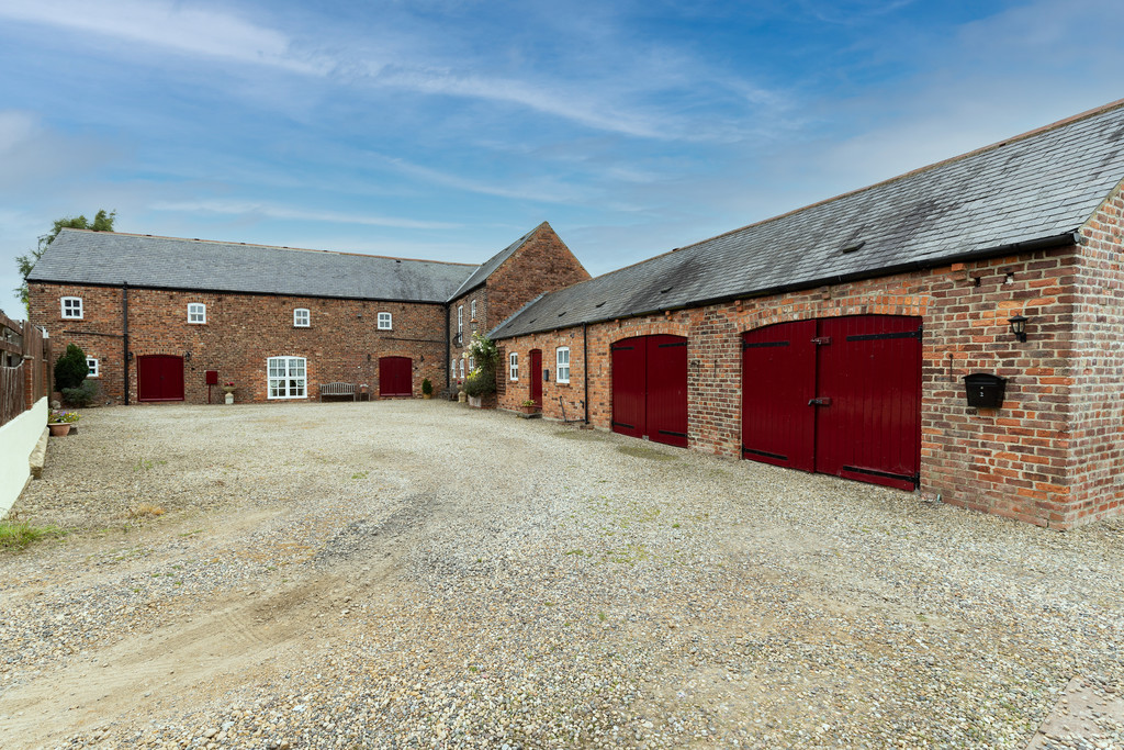 This fabulous barn conversion is currently working as two dwellings, however they lend themselves to a simple conversion to one main home. The property offers a private courtyard with a double garage, gated access to both sides and private rear gardens. A detached stable block with 4 indoor boxes, approximately 2-acre paddock along with an orchard plus lawned gardens with stunning far reaching open views completes this estate all set at the end of a private driveway.