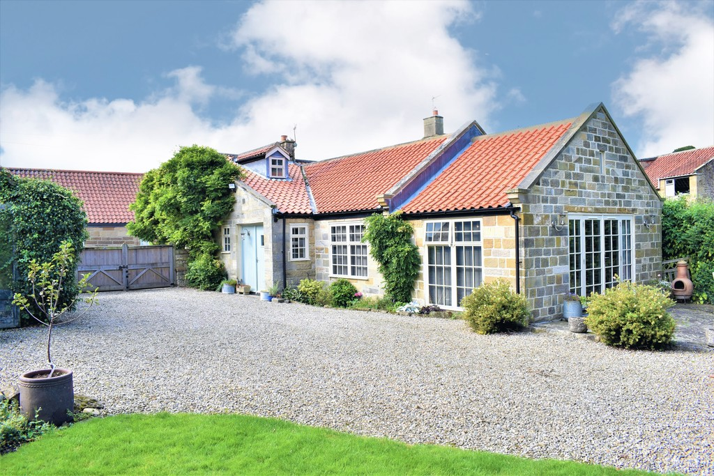 So deceptive from the front, this period cottage of immense charm and character occupies a first class site of almost .75 of an acre in  one of the area's most sought after villages. Extended & updated to an extremely high standard, the accommodation includes an open plan living kitchen, 4 bedrooms & outside, a  cinema room, gym & double garage. Viewing essential.