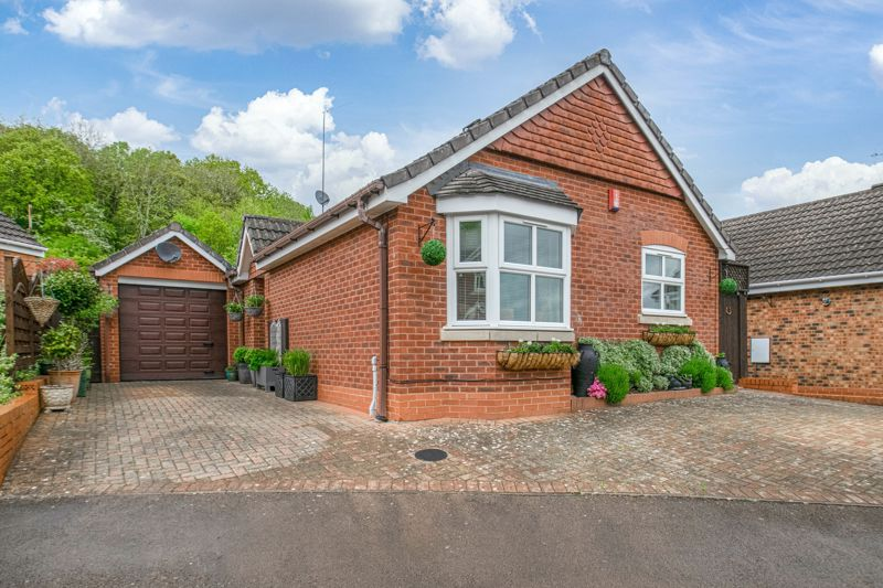 <br/><br/><p>An immaculate two-bedroom, detached bungalow, well placed in the sought-after residential area of Wirehill, Redditch.</p><p>The accommodation comprises: Entrance hallway, spacious lounge with a feature gas fireplace and bay window, fitted kitchen/diner providing a sink, gas hob, oven, dishwasher and washing machine, along with space for freestanding appliances, conservatory with French Doors and view to the rear garden, bedroom one with fitted wardrobes, good sized bedroom two, and the bathroom, providing a bath with overhead shower, sink and WC. <span> </span></p><p>Outside, to the rear is a beautifully landscaped and private garden with an initial patio area perfect for garden furniture, up to a gravelled area with mature planted features. The property benefits from backing onto Wirehill Woods, making for a private and scenic backdrop. To the front of the property is a vast private driveway providing ample off-road parking, access to the attached garage, and side gate access through to the rear.</p><p>Well placed in a sought-after residential area of Wirehill, the property benefits from being nearby to the Alexandra Hospital for medical facilities, countryside, wooded walks, and local shops. Redditch Town Centre is a short ride away boasting an assortment of leisure facilities and amenities such as shops, restaurants, bar and cinema, along with the local bus and train stations. Motorway networks M5 and M42 are easily accessible.</p>