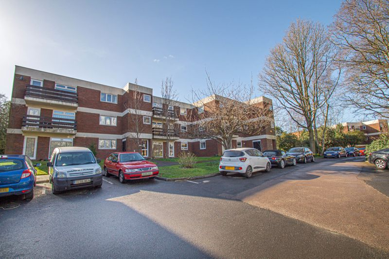 An ideal first purchase, a one bedroom first floor flat in a popular development, surrounded by trees set in communal grounds which encourage wildlife. <br/><br/>The property is entered via a secure entrance with stairs to first floor. The entrance hall has a viewing panel and intercom, cloaks recess to right hand side and built-in storage cupboards to the left. The living room is open plan to the kitchen and over looks the front balcony, white units line the kitchen, having an electric hob with lit steel canopy over and built-in oven beneath. Plumbing is placed for a washing machine and a space is available for an under counter fridge. A combination gas fired boiler sits to the far wall. The floors are carpeted and wood timbers line a feature wall, the pvc door and windows look out over the grounds towards the parking areas. The bedroom has a window to front, fitted wardrobes with mirrored doors and shelving to side. The shower room has been modernised fitted out with a shower enclosure, w.c. with recess shelving behind and a bowl top sink to cupboard beneath.<br/><br/>The property is offered with an under ground garage for one car, having up and over door to front. Locally there is a good range of shops and takeaways along Mount Pleasant and well as Headless Cross, including a doctors surgery, the nearby hotel has a bar, restaurant and notable gardens. Buses connect into the main town for the railway station and a major shopping centre.<br/><br/>