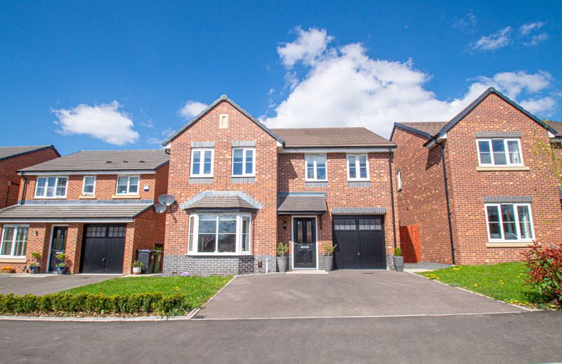 A rather impressive, four double bedroom detached home, situated off Church Road on Millward Gardens in Webheath. The property was built in 2017 by Taylor Wimpey and is part of a well laid out development close to open countryside.  <br/><br/>The layout is as follows: Pleasant hallway leading to a ground floor cloaks/w.c. The delightful front lounge has a wide bay window fitted Roman blinds, there is grey carpeting and a fashionable deep blue feature wall. The excellent kitchen/diner offers a good range of units, incorporating an inset sink to work surfaces, five ring gas AEG hob, integrated Zanussi fridge/freezer, dishwasher and oven, it also benefits from pull out storage, carousel fitting to corner, and soft close draws and doors. A separate utility room sits aside and is entered via a half glazed door. This contains an additional sink, integrated washing machine, space for a tumble dryer and various storage cupboards and shelving.<br/><br/>The first floor is given over to a family bathroom, a master bedroom with built-in wardrobes and access to a pleasant en-suite shower room. Generous guest bedroom two offers another en-suite shower facility. The two further bedrooms occupying the rear of the property are double rooms, one is currently used as a large office.<br/><br/>Outside: Views of trees sit opposite the property, the frontage has a driveway fronting the garage. Side gate access leads round to the rear garden, laid initially with a paved patio area leading to the lawn, which gently slopes up towards a sun terrace and a timber shed.<br/><br/>Other benefits include: Double glazing, gas central heating, encapsulated hot water tank, Karndean flooring running through most of the ground floor, which has also been fitted into the bathrooms.<br/><br/>