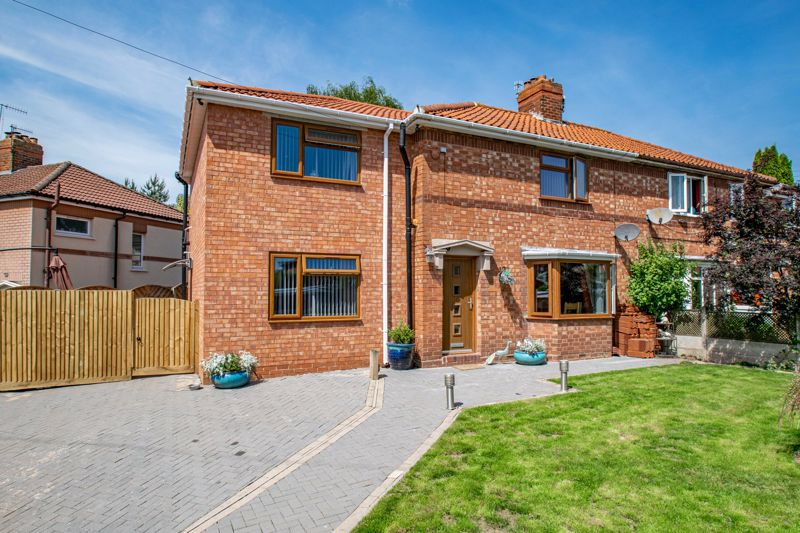 <br/><br/>A well-extended, four bedroom, semi-detached house; having been much improved by the current owners, occupying a generous corner plot within a popular residential area of Sidemoor, Bromsgrove.<br/><br/>In brief, the spacious internal layout comprises; Entrance hallway with stairs rising to the first floor landing; impressive open plan kitchen/living/dining area, with bay window to front aspect, a range of stylish fitted kitchen units, range style cooker with overhead extractor hood, and breakfast bar. A barn style door from the kitchen then gives off to a sizable utility room with plumbing for washing machine and space for additional appliances; beautifully presented lounge with front aspect view and door out to the rear garden.<br/><br/>Upstairs, the generous living space continues, with the first floor landing giving off to a  master bedroom, boasting integrated ceiling speakers, walk in wardrobe, and a contemporary en-suite shower room; three further good sized bedrooms and a modern family bathroom, fitted with a walk in steamer shower with options to connect a speaker system.<br/><br/>Externally the property benefits from a good-sized wrap around plot, with the rear of the property featuring covered patio seating area, large timber shed/workshop space and a block paved seating area to the side to timber fenced boundaries. The generous frontage of the property can be accessed via a side gate and exhibits a large gated, block paved driveway, well-maintained lawn with well stocked planters and further timber fencing to the front boundary.<br/><br/>The accommodation has been much improved by the current owners to benefit from gas central heating, double glazing throughout, composite front and side door, solid wood internal doors, CCTV system, and boarded loft space with fitted ladder and lighting.<br/><br/>Occupying an enviable corner plot, this spacious semi detached property, is well placed for local shops along Broad Street, a community centre, play are