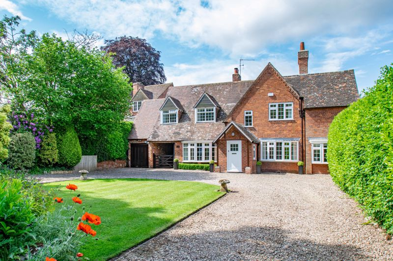 A truly exceptional example, of a substantial detached family home, featuring generous open plan family living, detached annexe, and extensive formal gardens, all situated off a private road in a highly desirable and sought after location of Burcot village, Bromsgrove.<br/><br/>The internal accommodation is accessed via a sizable entrance porch leading through to a bright and airy entrance hall, presenting a feature staircase rising to the first floor landing, and opening into a beautifully presented dining room to front aspect. From the entrance hall, doors radiate off to a stunning and sizable lounge with feature fireplace, dual aspect views and double glazed french doors out to the rear garden, a stylish open plan kitchen/breakfast room complete with an characterful feature log burner, range of fitted wall and base units, skylight, integrated five ring gas hob, double oven, dishwasher and inset sink, while a separate utility room presents space for additional appliances, access to a guest W/C and door out to the rear gardens. From the dining room a good-sized office/snug room is situated to the front of the property, completing the ground floor layout.<br/><br/>Moving upstairs the first floor landing establishes a sizable master bedroom which includes integrated wardrobe storage, access to a large four piece en-suite bathroom and walk in wardrobe; three further well-proportioned double bedrooms and a modern styled family bathroom complete with bathtub and separate shower cubicle.<br/><br/>The property also encompasses a well-presented detached annexe , which presents fantastic opportunity to convert into a  self contained accommodation or office space. The current annexe interior is laid as follows; lounge with spiral staircase rising upto a generous games room/office space having large storage area; and a modern ground floor shower room. <br/><br/>Outside, the residence sits on beautifully landscaped and extensive formal gardens, presenting well-maintained lawns