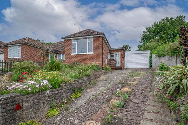 <br/><br/><p>A two-bedroom, semi-detached bungalow, placed in the highly sought-after residential area of Headless Cross, Redditch.</p><p>The accommodation briefly comprises: Entrance porch and hallway, kitchen with a separate front entrance, a pantry cupboard and space for appliances, spacious living room with a feature electric fireplace and sliding doors to the rear patio, conservatory with access to the rear garden, the attached garage and WC. Bedroom one has space for wardrobes and a recently fitted carpet, good-sized bedroom two has fitted wardrobes with sliding doors, and the bathroom provides a bath with overhead shower, sink and WC.</p><p>To the rear is an extensive, private garden, mainly laid to patio slabs with multiple mature planted areas. The rear garden further benefits from a separate summer house and green house. <span> </span>To the front of the property is a front garden area, a private driveway providing ample off-road parking, along with access to the double tandem garage featuring a separate workshop area.</p><p>Furthermore, the property benefits from double glazed windows and a boarded loft space.</p><p>Well situated in the popular residential area of Headless Cross, the property provides excellent access to the local amenities, shops, restaurants, well-regarded schools, and local bus routes. Redditch Town Centre is a short ride away boasting an assortment of further amenities along with the main bus and train stations.</p><p><span></span></p>
