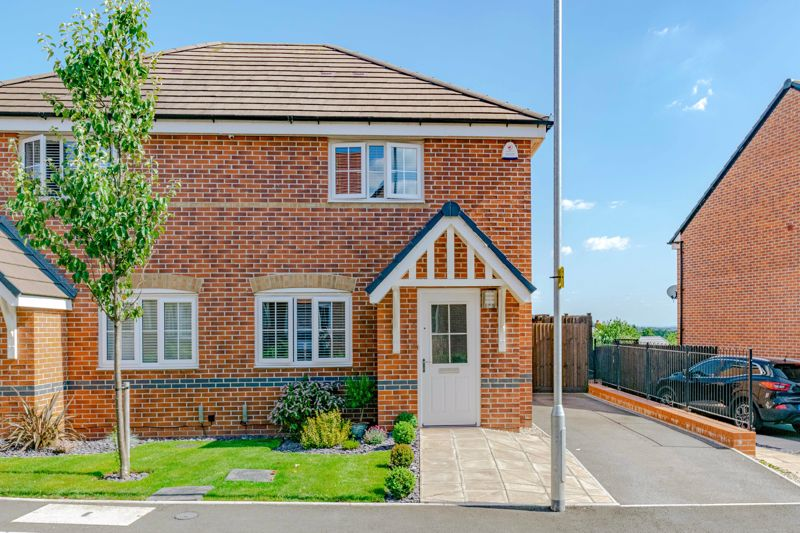 A beautifully presented, modern, two-bedroom semi-detached house constructed by Barratt homes in 2017, occupying a prime position on a new residential development within reach of Bromsgrove Town centre.<br/><br/>In brief, the immaculate interior of property comprises; entrance hallway giving off to a guest w/c, well-proportioned lounge having stairs rising to the first floor landing, contemporary fitted kitchen, benefiting from high spec integrated appliances to include - double AEG oven with electric hob and extractor hood over, tall fridge/freezer, washer/dryer, slimline dishwasher and inset sink with separate drainer and Franke mixer tap. Additionally, double glazed french doors open out to the rear garden.<br/><br/>Moving upstairs the first floor landing establishes a master bedroom with a sizable walk-in-wardrobe/dressing area, double bedroom two boasting spectacular elevated views over Bromsgrove, and a modern family bathroom suite complete with shower over bath.<br/><br/>Further benefits include; combination gas central heating, double glazing throughout, porcelain tiled floor in kitchen/diner, high quality Townsend carpets, LED down lighting in kitchen/diner, main bathroom and walk-in-wardrobe, Karndean flooring in main bathroom, CCTV system, external security light, external power sockets, boarded loft space with fitted light, and chrome light/socket fixtures throughout.<br/><br/>Outside to the rear, the property enjoys a beautifully landscaped garden having initial paved patio area with timber shed store and steps down to an additional Indian sandstone paving seating area, well-maintained lawn, composite decking area to the rear and timber fenced boundaries. A side gate allows for access to the two-car driveway and entry to the attractive landscaped frontage.<br/><br/>The property is situated on the sought-after Norton Farm development popular for its proximity to Bromsgrove town centre offering a variety of leisure facilities, restaurants, shops, pubs and