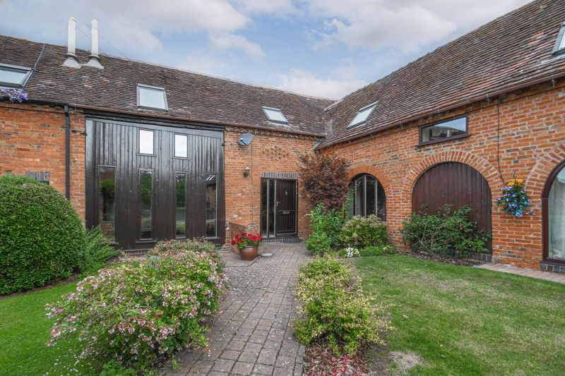 <br/><br/><p ><span > </span></p><p ><span ></span></p><p ><span >A characterful three-bedroom barn conversion, boasting an impressive master bedroom with dressing room and en-suite bathroom, generous living space, a double garage and a private courtyard garden, well situated in the charming grounds of the Coach Farm Barns development in Hunt End, Redditch.<br/><br/></span></p><p ><span >The ground floor accommodation comprises: Spacious hallway with an original stone flooring and stairs to the first-floor landing, the double doors to the left lead you into the large sitting room with a feature log burner and floor-to-ceiling windows. To the right of the hallway is the fitted kitchen with a centred island, period beams and access to the private garden, then into the dining room with a feature arched window with a view of the front courtyard. The ground floor accommodation further benefits from a handy guest WC/cloakroom. </span></p><p ><span ></span></p><p ><span >The first-floor landing establishes: Master bedroom with a dressing room and en-suite bathroom providing an elegant roll top bath, separate corner shower, sink and WC, two further double bedrooms with feature skylight windows and space for wardrobes, and the family bathroom. <br/><br/>Outside, to the rear the barn has a private courtyard garden with a decked entertaining area and backed onto open countryside fields. The property further benefits from allocated car parking and a double garage. </span></p><p ><span ></span></p><p ><span >Well placed in Hunt End, the property is 4 miles from Redditch Town Centre and all of its amenities including shops, supermarkets, restaurants, and cinema, along with the local bus and railway stations, as well as being a few miles away from the villages of Feckenham and Hanbury. The M42 and M5 motorways are easily accessible providing great commuter links. </span></p>