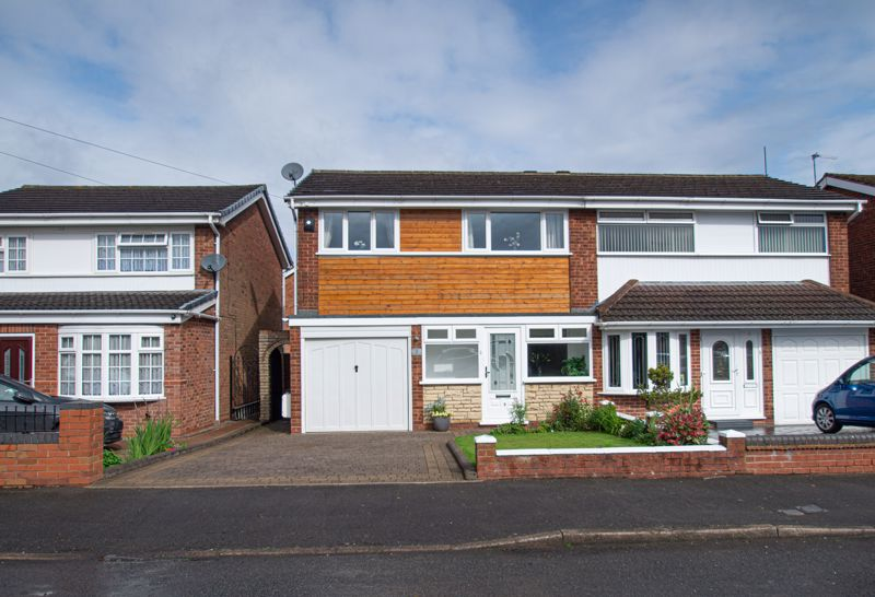 A truly striking, three bedroom semi detached home, upgraded to an exceptionally high standard throughout. <br/><br/>The internal layout briefly comprises: Wide double glazed entrance porch with feature floor and ample room for furniture. Lounge/diner, tastefully decorated throughout, having feature fireplace, under stairs cupboard and sliding patio doors to the rear garden. The kitchen has been recently fitted out by Avanti Kitchens, offering granite work surfaces, grey units, integrated sink, built-in oven, microwave/grill, dishwasher and fridge/freezer, as well as a washing machine. A glazed pvc door leads to the side entry way. <br/><br/>Stairs rise from the dining area to reach the landing, having a loft hatch with ladder installed to a mainly boarded and insulated roof space. Bedroom one features a range of Avanti fitted wardrobes and side tables. Double bedroom two overlooks the rear garden and also boasts feature flooring. Ample single bedroom three is fitted with two wardrobes, including one to the alcove.  The family bathroom will not fail to impress, having contemporary wall tiling, a separate shower enclosure as well as a full sized bath, plus a floating sink unit with draws beneath. <br/><br/>Outside has a neat front garden with a driveway in front of the integral garage. A side gate leads to the sunny aspect and private rear garden, with a full width patio leading onto the lawn where your eyes are drawn to the pleasant sun deck at the far end.<br/><br/>This property is ideally situated for families due to its close proximity to local schooling, an abundance of local shops, a medical practice, library and parks as well as excellent bus routes, the M5 motorway network and main line train links at Rowley Regis railway station for commuting to Birmingham and beyond.