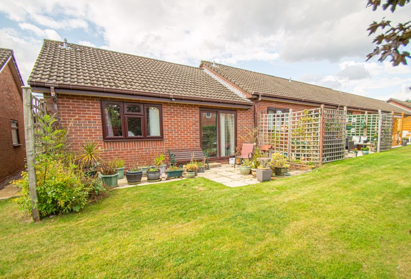 A rather pleasant, two bedroom end of terrace retirement bungalow. Set well back in a small development of similar properties designed for the over 60's Set within well-maintained communal gardens with some parking for residents. <br/><br/>The layout briefly comprises: Entrance, having covered area and external cupboard, the front hall leads on to a main hallway. Fitted kitchen, offering a built-in oven with electric hob above, sink beneath the window, space for an upright fridge/freezer, plumbing for appliance and ample work surfaces. Well-proportioned living room, with fireplace containing a coal effect electric fire, patio doors to the seating area and access to the main bedroom. A further door leads into an inner hall with storage cupboard, airing cupboard and door to the shower room. This boasts a range of fitted units backing the sink and w.c. and a corner shower enclosure has a wall mounted seat. Bedroom two sits opposite the kitchen and over looks the front, there is a loft hatch to the ceiling.<br/><br/>Other benefits include: Double glazing and electric night storage heating to most rooms. Beyond the patio are communal lawns and a timber shed has been placed at the rear. There is a small information room containing a library for the development occupiers.<br/><br/>Locally shops sit at Headless Cross some yards away, including a main chain convenience store, hardware supplier, chemist, medical centre and some takeaways, with further shops on Evesham Road. A short car ride will bring you within reach of Morton Stanley Park and a golf club. Redditch town centre is reasonably close for main shops, restaurants and multi screen cinema.<br/><br/>