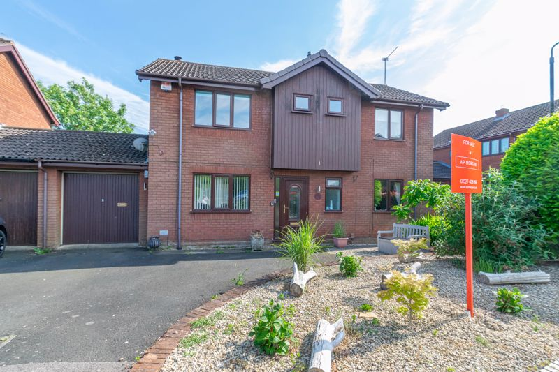 A spacious four bedroom link detached home set within a pleasant cul-de-sac on the fringes of Church Hill North. <br/><br/>The layout briefly comprises: Pleasant entrance hallway giving access to the modern guest w.c and doors to the following rooms. Through living room, boasting a log burner to inglenook fireplace, wall lighting, wooden floor and double doors to the rear garden. Separate dining room to front. Excellent well thought out breakfast kitchen, having striking composite work surfaces with integrated sink, built in oven and microwave, fridge/freezer, plumbing for dishwasher, under cupboard spot lighting and superb breakfast bar, there is also a walk in pantry and pvc door leading to the garden.<br/><br/>The first floor accommodation is given over to four double bedrooms, the master containing a wall of fitted wardrobes and access to its own upgraded en-suite shower room. The family bathroom offers a mixer attachment over the bath, cupboards beneath the sink, deep display shelf and towel radiator.<br/><br/>Outside: The front garden has a driveway for several cars and a single attached garage of ample proportion. Access from the rear reaches the 9ft square utility room, with plumbing for appliances and room for storage. The rear garden has been landscaped with decorative paving, slate infill and raised beds. There is a summer house included as well as a log store.<br/><br/>Other benefits includes gas central heating and double glazing.<br/><br/>Locally shops, a post office and community facilities are reasonably close to the property and bus connections are available running into Redditch town centre. A short drive gains access to Beoley village with small hall and school. The property is on the reachable side of Redditch for the M42 motorway for commuting to surrounding areas.