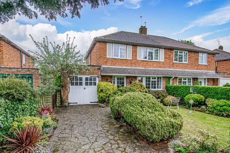 <br/><br/>A well-presented, semi-detached, family home, boasting a sizable garage (incorporating fitted storage cupboards and worktops) and an open plan lounge/dining room with exposed beams. The property is situated within a sought after location of Wychbold, Droitwich, ideal for ease of access to nearby road and commuter links including the M5; and benefits from being offered with no onward chain.<br/><br/>Internally the well-laid out interior comprises; a sizable entrance hallway with feature solid oak parquet wood flooring, which continues through into an impressive open plan living/dining room complete with exposed beams, Cotswold stone and welsh slate fireplace,  and double glazed UPVC french doors out to the rear garden. A country style exposed beam kitchen offers a range of wall and base units with integrated oven, electric hob with extractor hood over; space for a table and chairs, with a door through to a separate utility room,providing plumbing for a washing machine; ground floor W/C and integral door to the garage.<br/><br/>Moving upstairs the first floor landing establishes three good-sized bedrooms, two of which are doubles and all having built in wardrobes; a family bathroom with shower over bath, spacious airing cupboard, heated towel rail and separate W/C.<br/><br/>In addition the property benefits from a boarded loft space with light and integral loft ladder for easy access.<br/><br/>Externally the rear of the property enjoys beautifully landscaped, mature leafy gardens featuring patio seating areas, ornamental pond with water feature, garden shed, and lawn to planted borders. A side access gate allows entry to the front of the property, which further benefits from a mature fore-garden and drive with access to the garage via side hung garage doors.<br/><br/>Located in a popular location opposite approximately an acre of open green in the small village of Wychbold, offering convenient access to the M5 and A38 for links into Birmingham and Worcester.