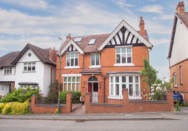 A fine example of a double fronted detached property of fine character, reachable for the main shops, bus and railway stations, cinema and Restaurants. We believe the property to be built somewhere around 1910, within a well established road of similar properties, with far reaching rear views from its elevated position. The house has been sympathetically updated, mindful of preserving the original features.   The layout briefly comprises: Enclosed porch, with decorative tiled floor. Delightful reception hallway, with under stairs storage cupboard and a ground floor cloaks/w.c. Main sitting room to right with striking bay window to front. Through lounge/diner, split with a wide opening, also with fireplace and patio doors to the rear sun decking. Modern fitted kitchen, having double oven and hob, pull out storage, walk-in pantry cupboard, hard surface work tops, and plumbing for a washing machine. A door opens to a heated conservatory, with solid roof having inset lighting.   The first floor is arranged around a stunning landing, leading to 3 double bedrooms, the master with access to a nursery/study with door to the landing. The family bathroom has been upgraded and provides enough space for both a bath and separate shower enclosure. The roof space accommodation was added during the 90's and comprises: Double bedroom space, with raised landing in front, having eaves space to left hand side with roof windows and a dressing area to right. This has a door leading into an en-suite shower room with walk-in linen storage.   Outside: A stunning established rear garden is fronted by a substantial elevated balcony to capture the views, creating a work space canopy beneath, with access to the cellar.  Other areas of note include a timber pergola and path leading to the rear double garage, with 5 car parking to a driveway, accessed from Bentley Close.