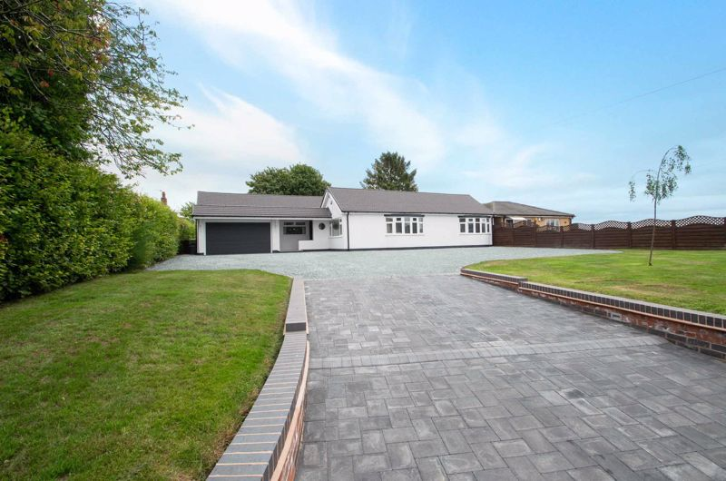 This superb four bedroom bungalow, finished to a high standard throughout, and with stunning views of the Clent Hills.<br/><br/>The property in brief: Entrance hall leading to the dining room with sky-lights, which lies open to the lounge which benefits from a built in TV unit with fireplace and sliding patio doors to the rear garden. There is also a play room following on from the dining room. Through to the modern kitchen/breakfast room which has Neff appliances including a dishwasher, electric hob and double oven as well as space for an American fridge/freezer. From the kitchen is a utility room with plenty of storage, as well as a further utility room in the garage providing space for a washer and dryer. Back through to the master bedroom which benefits from integrated wardrobes and a modern en-suite. Double bedroom two has a built in wardrobe with a sliding door, and double bedroom three also benefits from an en-suite. There is a further well-sized bedroom four which is currently being used as an office. The family bathroom is a modern white suite. All bathrooms have Roca fittings and Vardo taps.<br/><br/>Outside: The rear garden offers a patio area for garden furniture, leading onto a lawn. Running alongside is a pathway to the end of the garden where there is further patio space. The rear garden offers stunning views of Clent Hills. To the front is a large pebbled driveway for several cars, and a garage for extra private parking or storage.<br/><br/>This property is situated near to the Stourbridge Road which offers commuting routes to Birmingham, Hagley and the M5. For families, there are local schools nearby as well as Clent Hills and local woods offering an ideal outdoor space for children. There are local shops and amenities nearby, including eateries and pubs.